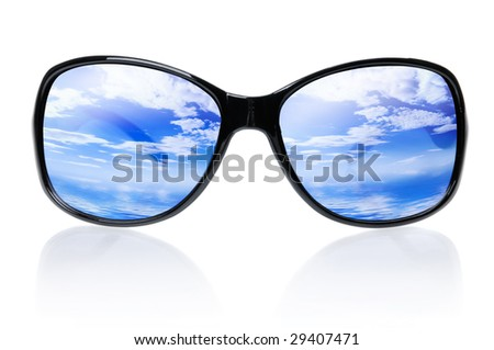 Blue skies and sea reflecting in sunglasses isolated on white background - stock photo