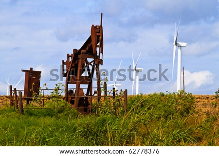 Blue skies, clouds, wind and oil wells on the Texas prairie - stock photo
