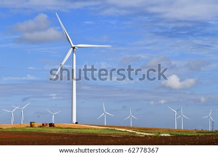 Blue skies, farm land, green crops, and rolling hils - stock photo