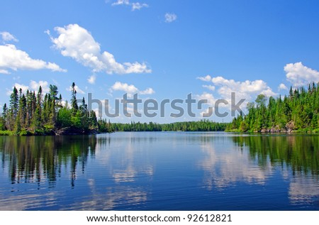 Blue Skies on South Temperance Lake in the Boundary Waters Canoe area - stock photo