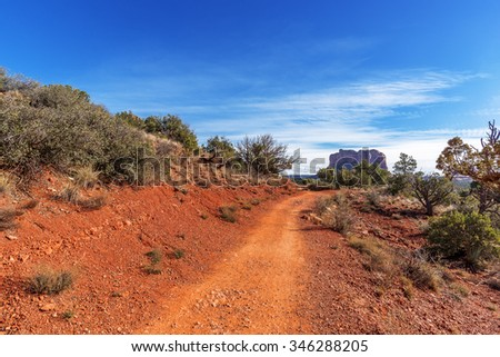 Blue Skies & white clouds in Red Rock Country near Sedona, Arizona. Panoramic vistas. Biking, hiking, & walking trails. Beautiful sunrises & sunsets. Unsurpassed Southwestern landscape colors. - stock photo