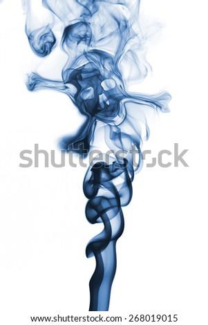 Blue skull formed in smoke - stock photo