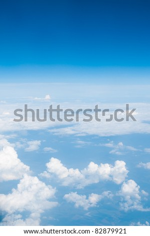 Blue sky above the clouds. - stock photo