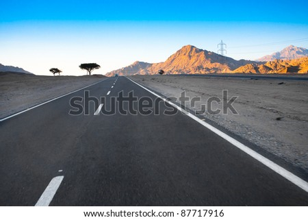 Blue sky and beautiful mountain landscape with road - stock photo
