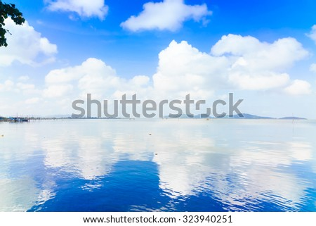 Blue sky and bright cloudy at Songkhla Lake,Songkhla Southern Thailand. - stock photo
