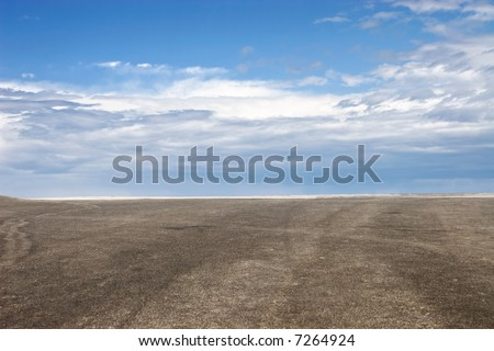 Blue sky and brown ground perspective view.