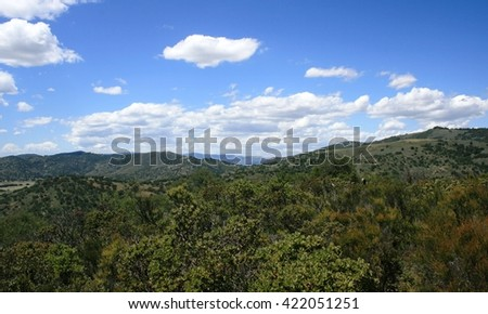 Blue sky and clouds above rolling hills, San Diego County, CA - stock photo