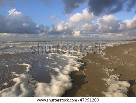 Blue sky and clouds and a deserted beach - stock photo