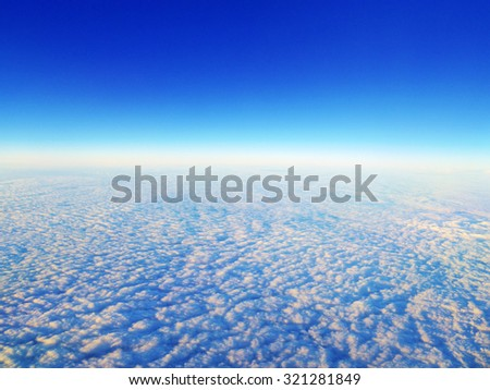 Blue sky and clouds. The view from the plane. - stock photo