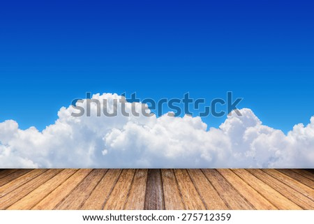 Blue sky and clouds with space for add text above with wooden floor. - stock photo
