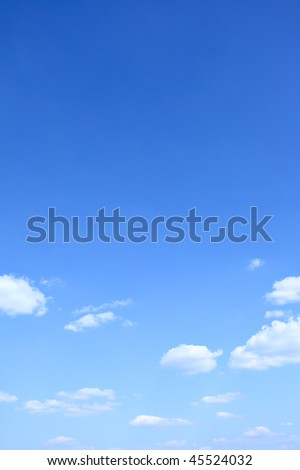 Blue sky and clouds with space for text above - stock photo