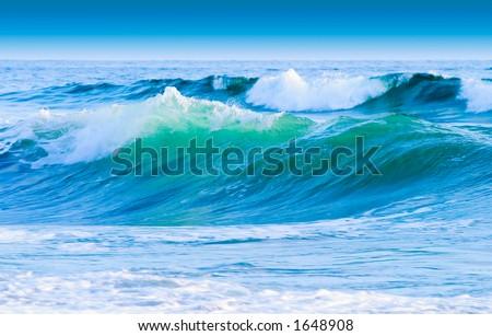Blue Sky And Coastal Waves - stock photo