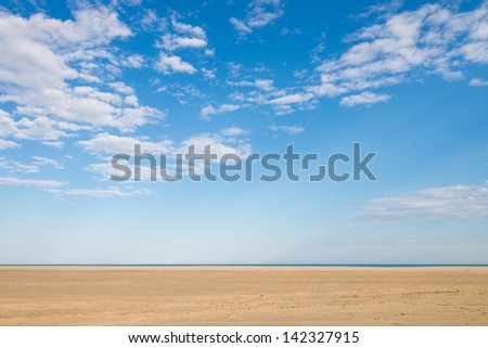 Blue sky and golden sand, a nature background - stock photo