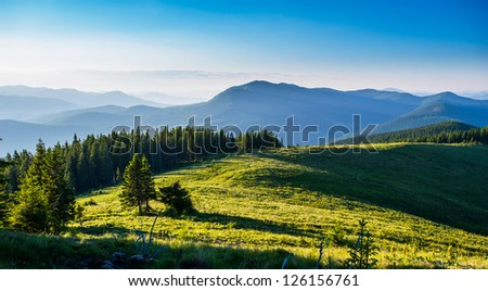 Blue sky and green hills. Summer mountain landscape