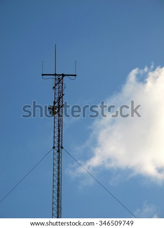 Blue sky and lonely electricity post with cloud. - stock photo