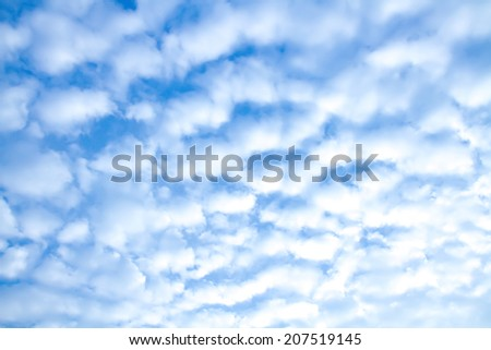 Blue sky and lots small clouds - stock photo