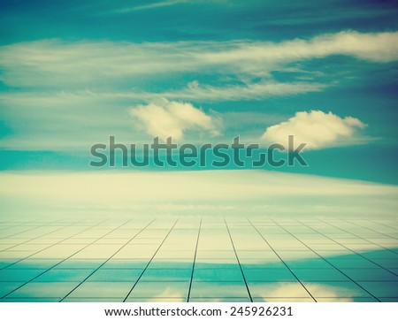 blue sky and mirror floor, cloudy background, retro film filtered, instagram style  - stock photo