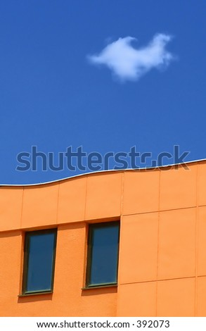 blue sky and orange building - stock photo