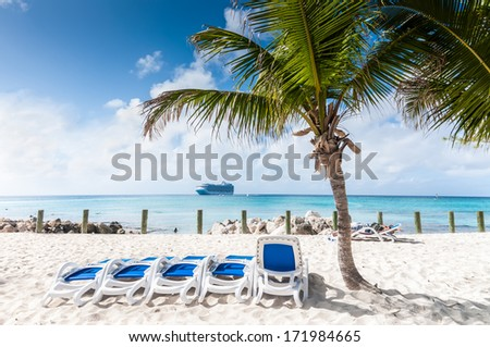 Blue sky and paradise, the Tropical island in the Bahamas, and a cruise ship on the horizon - stock photo