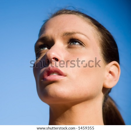Blue sky and pretty girl - stock photo