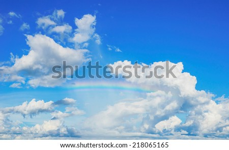 blue sky and rainbow - stock photo