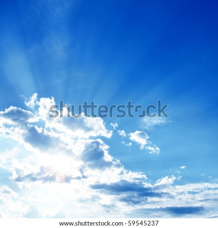Blue sky and rays of light. - stock photo