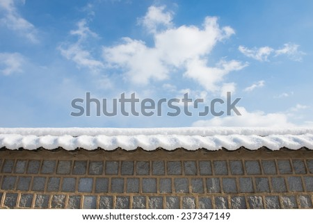 Blue sky and Roof in snow - stock photo