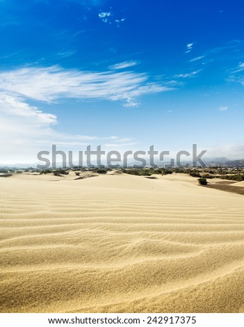 Blue sky and sand dunes. Sunny day. Canary islands, Maspalomas. Spain.  - stock photo