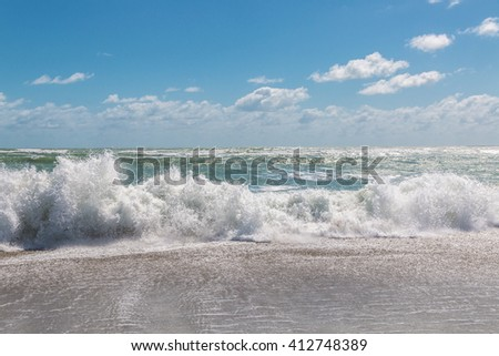 Blue sky and stormy Atlantic ocean at morning. - stock photo