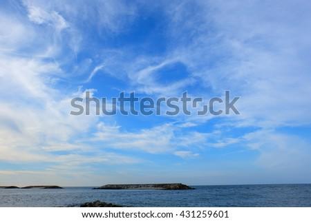 Blue Sky and Tropical Island - stock photo