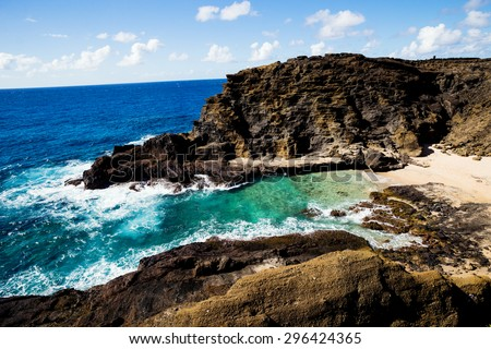 "Blue sky and water ""From here to Eternity beach"" aka Halona Beach Cove on the south coast of oahu in Hawaii - stock photo"