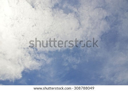 Blue sky and white cloud with green tree - stock photo