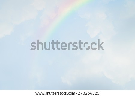 Blue sky and white cloud with rainbow - stock photo
