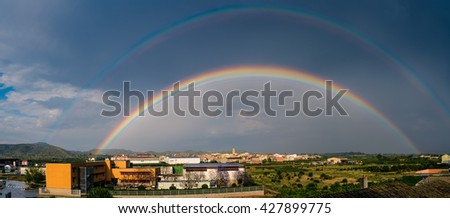 Blue sky and white cloud with sun light and rainbow