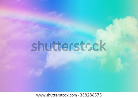 Blue sky and white cloud with sun light and rainbow,pastel tone. - stock photo