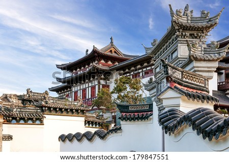 Blue sky and white clouds, ancient Chinese architecture - stock photo
