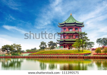 Blue sky and white clouds, ancient Chinese architecture: garden. - stock photo