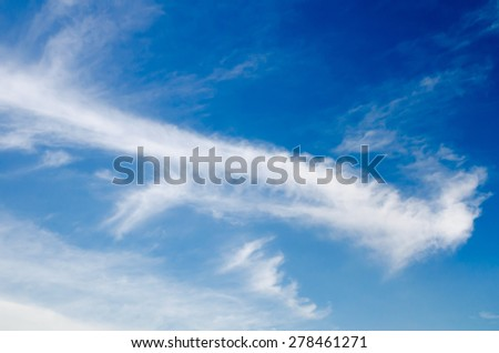 blue sky and white fluffy cloud background