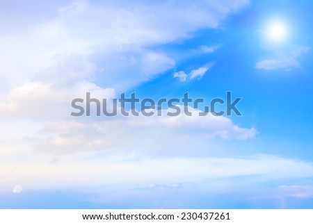 blue sky and white fluffy clouds and sun