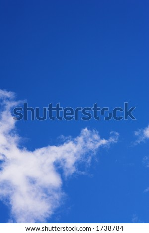 Blue sky and white puffy clouds - For use as fill in backgrounds in designs and photo retouching