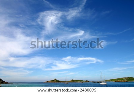 Blue sky and wispy clouds, Isles of Scilly, UK. - stock photo