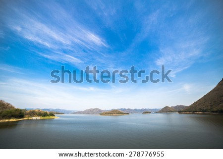 blue sky at reservoir - stock photo