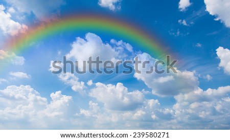 Blue sky background and white clouds with rainbow - stock photo