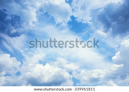 blue sky background as frame with cumulus clouds - stock photo