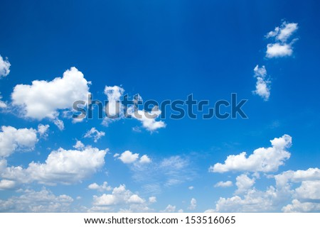 blue sky background with a tiny clouds - stock photo