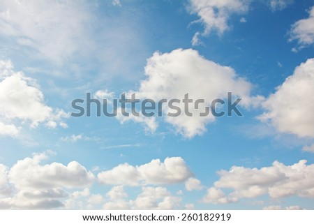blue sky background with cumulus clouds - stock photo