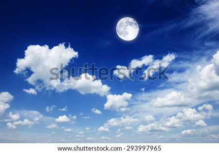 Blue  sky background with puffy  white clouds and moon - stock photo