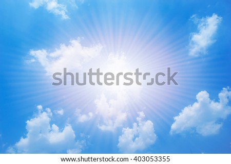 Blue sky background with white clouds and light sun.