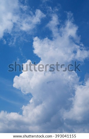 Blue sky background with white clouds. Blue clear sky panorama with cloud closeup. - stock photo