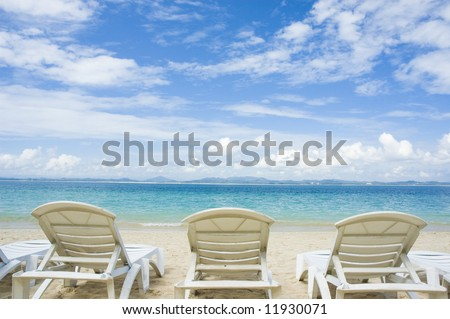 blue sky beach with chairs - stock photo